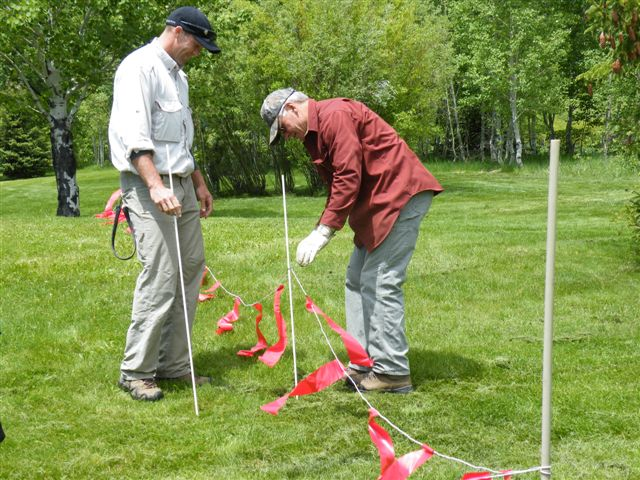Randy & Roger, members of the field team, learn to set up turbofladry